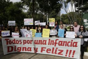 People protest against child abuse, demanding stronger penalties for violators, in downtown Asuncion Paraguay, Monday, May 11, 2015. The nation has been split over the case of a pregnant 10-year-old girl denied an abortion. The argument over the girl has drawn unusually strong attention to the issues of child abuse and abortion, which is banned in all cases except when the mother's life is in danger. Police said Saturday they had arrested the girl's fugitive stepfather, who is accused of raping the child.  (AP Photo/Jorge Saenz)