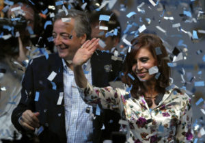 Argentina's presidential candidate Cristina Fernandez de Kirchner, right, and Argentina's President Nestor Kirchner,  wave to supporters at their headquarters in Buenos Aires, Sunday, Oct. 28, 2007. Early official results and several major exit polls suggested that Fernandez de Kirchner won the presidency Sunday by a large enough margin to avoid a runoff. She would be the first woman in Argentina elected to the post. (AP Photo/Daniel Luna) Argentina Elections